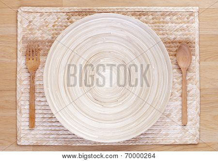 wooden spoon and fork and empty wooden dish