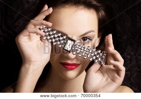 Fashion beautiful girl with glamour jewelry clock.