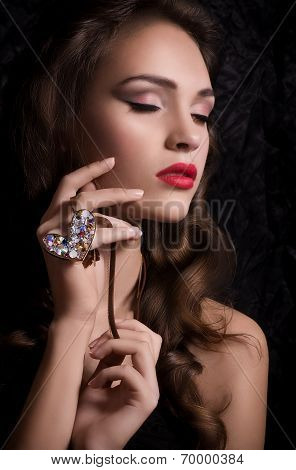 Fashion beautiful girl with jewelry precious decorations.