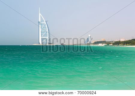 DUBAI, UAE - 2 APRIL 2014: Public Jumeirah Beach in Dubai, UAE. Jumeirah Beach is a white sand beach that is located and named after the Jumeirah district of Dubai.