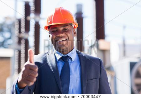 happy african industrial manager with thumb up at substation