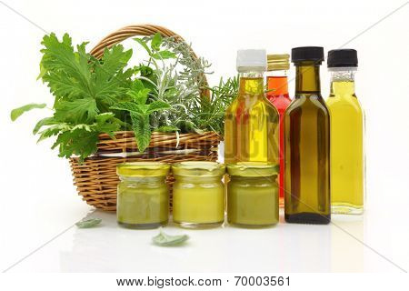 Fresh herbs in wicker basket and natural cosmetics