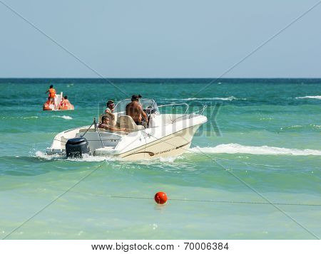 People Riding Motor Boat On The Black Sea