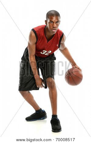 Young African American basketball player dribbling ball isolated over white background