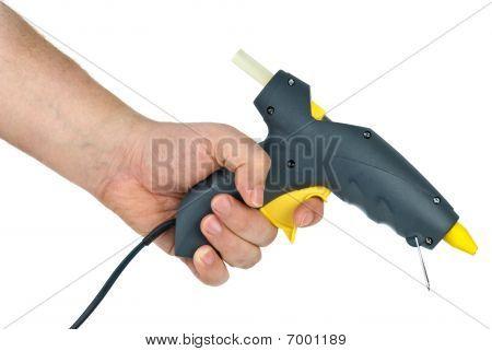 Klebepistole holding hände