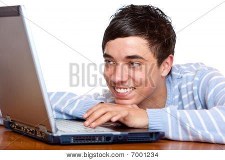 Young Happy Smiling Male Teenage Student Use Computer Laptop