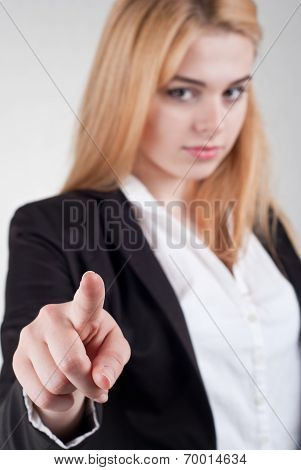 Beautiful Businesswoman Pointing At Camera On A White Background