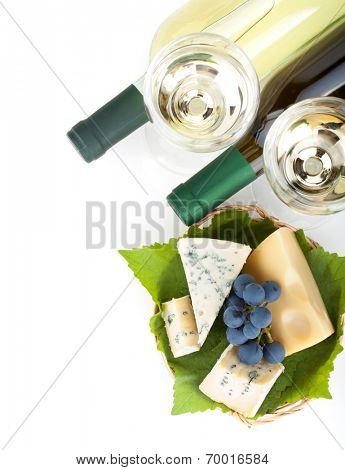 White wine, cheese and grape. Closeup. View from above. Isolated on white background