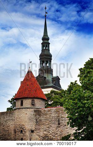 View on a tower of a city wall and St. Nicholas' Church (Niguliste). Old city Tallinn Estonia