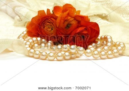 Flowers And Pearls On The Background Of White Lace