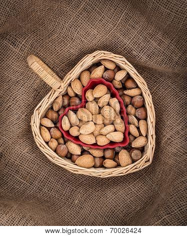 Heart Shaped Basket And Bowl With Almonds And Hazelnuts