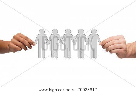 community, unity and teamwork concept - multiracial couple hands holding paper chain people