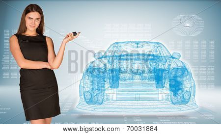 Businesswoman with key and wire frame car