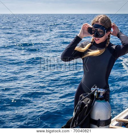 Beautiful Caucasian Woman Getting Ready for Scuba Diving