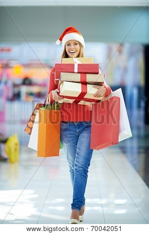 Woman with gift boxes in the mall
