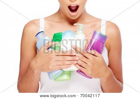 Woman with bottles of different hygiene products