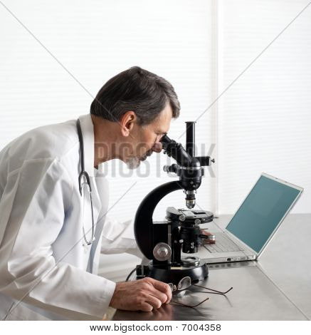 Doctor Or Scientist At The Microscope