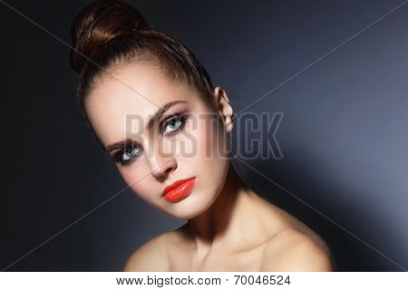 Young beautiful woman with stylish make-up with hair bun