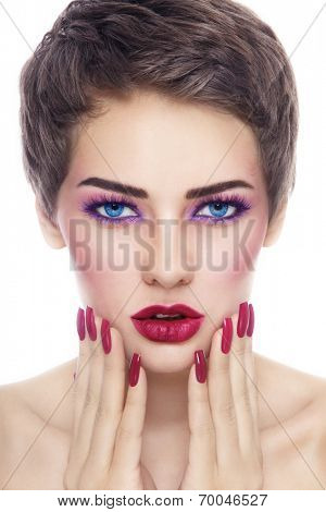 Portrait of young beautiful woman with stylish make-up and long nails over white background