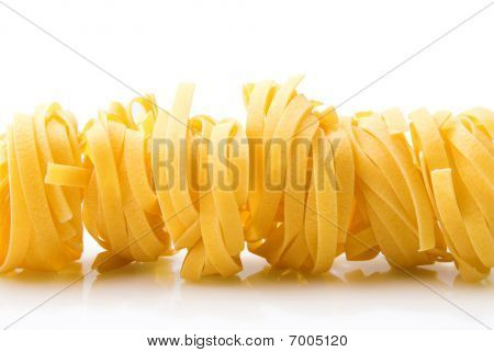 Row Dry Nest Pasta On White With Reflection