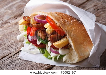 Doner Kebab With Meat, Fried Potatoes And Vegetables