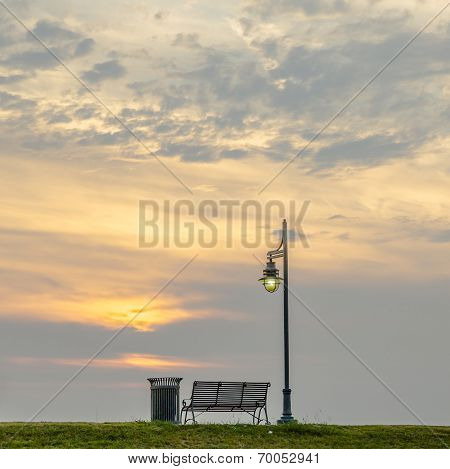 bench at the levee of the Mississippi at baton Rouge in sunset