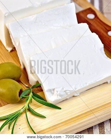 Feta With Olives On A Brown Cloth