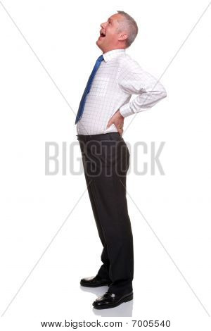 Mature Businessman Yawning Side View