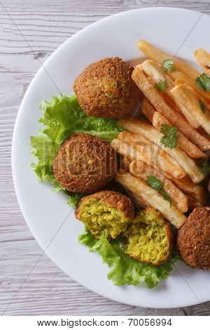 Falafel With French Fries, Lettuce Top View Vertical
