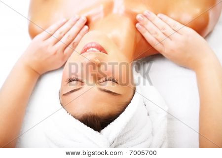 Beautiful smiling woman getting a massage.