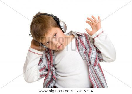 Boy In Headphones Listens To Music