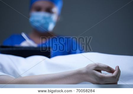 Doctor Noting Death Certificate