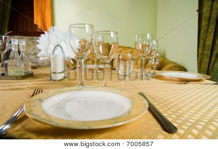 A Restaurant Table With Cutlery