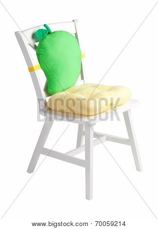 wooden chair with a cute cushion and pad
