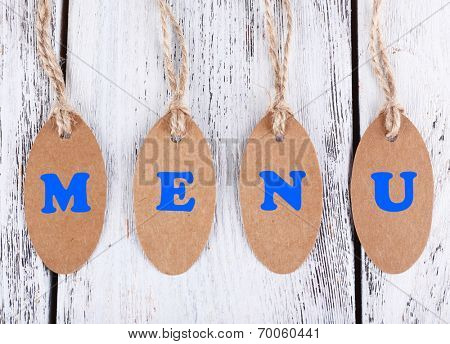 Menu tags on wooden background