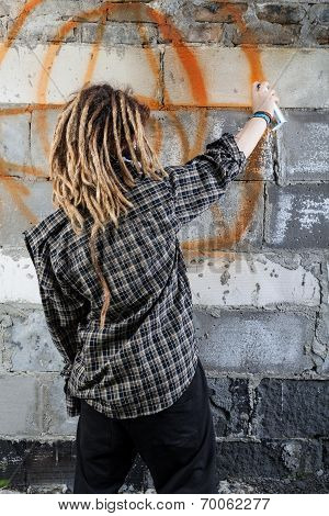 Young Vandal Drawing Graffiti