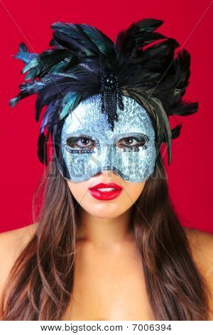 Woman Wearing A Masquerade Mask Red Background