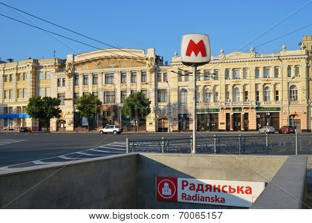 KHARKOV, UKRAINE - JUNE 9, 2014: Entrance to the subway station Radianska on the square with the same name. Found in 1975, Kharkov subway system now carry about 1 million passenger every day