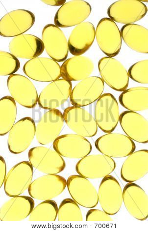 Close Up Of Yellow Gel Capsules.