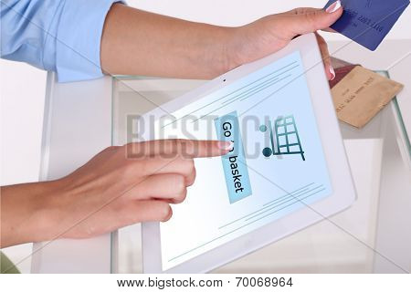 Concept for Internet shopping: hands holding tablet