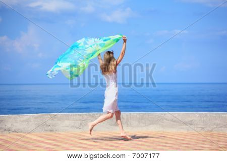 Beautiful Young Woman With Fabric Running On Quay