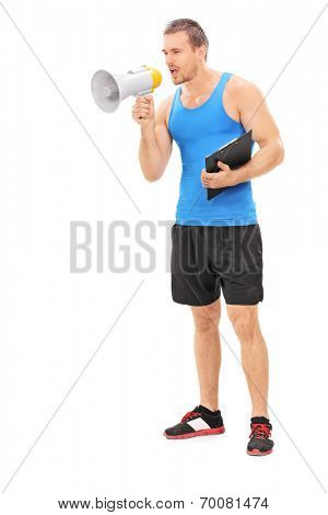 Full length portrait of a fitness instructor shouting on a megaphone isolated on white background