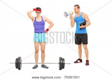 Coach motivating a nerdy guy to exercise, with a megaphone isolated on white background