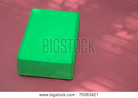 Pink Yoga Mat And Green Block