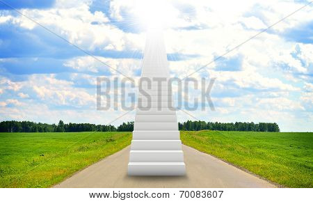 Stairs in sky with green grass, road and clouds