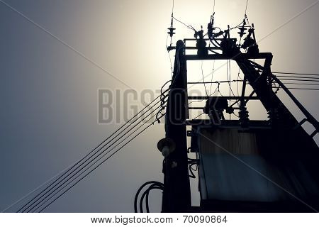 Sun Backlight Under The High-voltage Tower In The Background