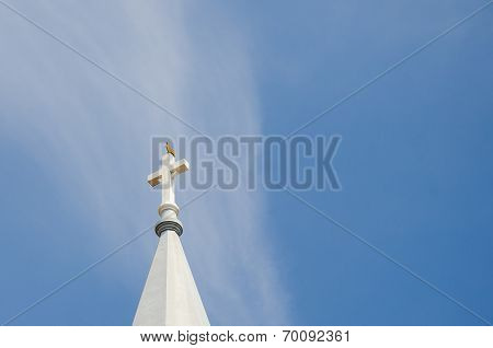 Church steeple, rooster on top with blue sky