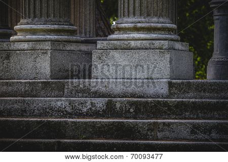 stairs, Greek-style columns, Corinthian capitals in a park