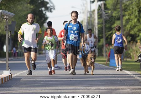 Bangkok Thailand-august 10: Unidentified People Running On Track In Marathon Running Competition