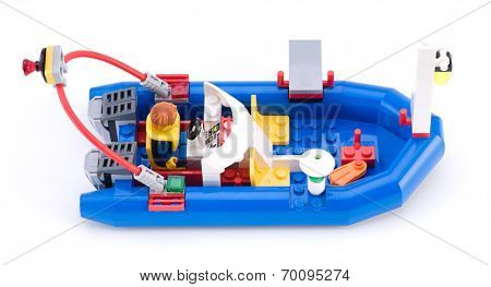 Ankara, Turkey - April 04, 2012: At LEGO City Marina, minifigure wearing life jacket driving blue dinghy isolated on white background.